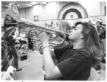 Student Elain Pino plays the mellophone during band practice, Santa Fe, New Mexico