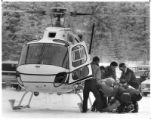 Rescuers load a 16-year old lost overnight near Santa Fe Ski Basin into a State Police helicopter,...