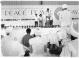 At Sikh gathering for Peace Prayer Day, Chinese and Chinese-American students lead a moment of...