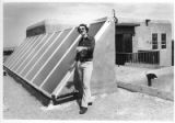 Andrew Cornett explains a residential solar collector, Santa Fe, New Mexico