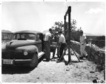 Workers at Los Alamos National Laboratory transport equipment for nuclear test at Trinity Site,...
