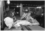 Carmen Marsh, left, employee of the La Fonda hotel, gives directions to New Yorkers Alan and...
