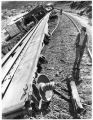 Fireman Greg Martinez inspects a train derailment, New Mexico