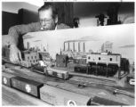 Bernard Brock operates a model railroad exhibition that stretches 160 feet inside the DeVargas...