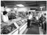 Max Cordova and Lloyd Maestas visit with propietors of Tafoya's General Store, Truchas, New Mexico