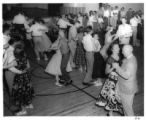 Group at dance, possibly at the New Mexico Bus Drivers Institute, Silver City, New Mexico?