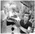 Ray Sandoval, age 14, with his homemade 6-foot Zozobra replica, Santa Fe, New Mexico