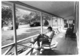Guest on porch of Wortley Hotel, Lincoln, New Mexico
