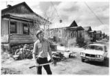 Noel Ward in front of houses in Madrid, New Mexico