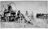 Pioneer family by covered wagon