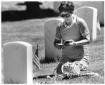 Sarah Sanchez pays respects on Memorial Day at Santa Fe National Cemetery, New Mexico