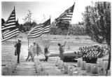 Bataan veterans display American flags at the National Cemetery for Memorial Day, Santa Fe, New...