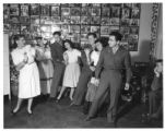 Marie Louise Wilson, teaching dance to GIs and hostesses at the USO Club, Santa Fe, New Mexico