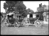 Two stagecoaches presented to the Historical Society of New Mexico by Mrs. Arthur Seligman, Palace...