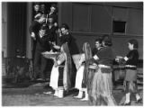 Pueblo women greeting Navy soldiers on train