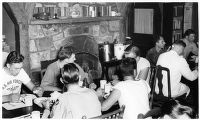 Army Air Force servicemen eat a meal at a convalescent center outpost near Forest Park