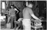 Army Air Force servicemen work in the woodshop at a convalescent center outpost near Forest Park