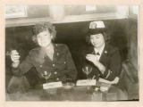 Dorothy Holt (right) in uniform, smoking in the Rose Room, Palace Hotel, San Francisco, California