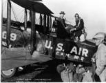 Charles Lindbergh and Green load first sack of cargo into airplane