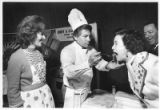 Clara and Jerry Apodaca give Della Montoya a bite of steak picado