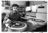 Art Encinias, district judge, spins records at KMIK Radio during his oldies show