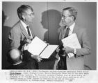 Associated Press correspondent Bill Feather (right) being honored by Governor Garrey Carruthers,...