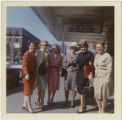 Gloria Stacy, third from left, and other women, stand below theater marquee, Buffalo, NY