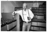 Mike Levis, owner of Santa Fe Brewing Co., with cases of Pale Ale