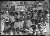Group of children and young adults wear sombreros at waterfall, Mexico