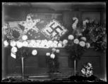 Casket and flowers with swastika design
