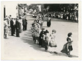 Children parade during Santa Fe Fiesta, Palace Avenue looking east