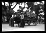Cowboys and oxen-drawn cart during Days of '49 parade, Raton Street