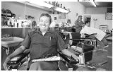 Barber Pat Candelaria in his shop, Santa Fe, New Mexico