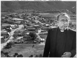 Father Bendito Cuesta at overlook of Villanueva village, New Mexico