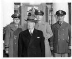 From left to right Brigadier General Larry B. McAfee, Governor John Dempsey and two unidentified...