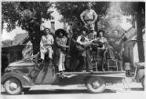 Unidentified band poses with instruments on truck