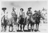 Unidentified women on horseback in cowgirl attire