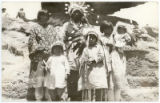 Unidentified family poses in traditional costume at Santa Clara Pueblo