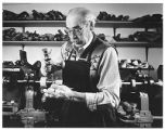 Cobbler David Gallegos in his shop, Santa Fe, New Mexico