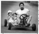 Paul Padilla drives nieces Renee Padilla and Jessica Olivares down Sam Street