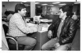 New Mexico Department of Labor job councilor Dr. Charles Pacheco interviews job seeker Florentino...