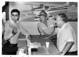 Greg Ulibarri, police lieutenant, evicting Santa Fe Aviation and its owners, David and Jim Hayes,...