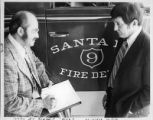 Joe Valdes, mayor of Santa Fe (left), meeting with Fire Department