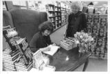 Judith Van Gieson, author, signing a book for Jody Adams at Waldenbooks in Villa Linda Mall
