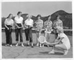 Marijohn Sundt demonstrating proper racket grip at Cimarroncita Ranch Camp