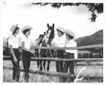 Four girls with a horse at Cimarroncita Ranch Camp