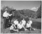 Cowgirl counselor with girls and a horse at Cimaroncita Ranch Camp