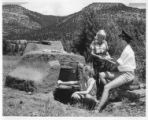Girls firing pottery in an outdoor kiln  at Cimarroncita Ranch Camp