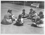 Young campers receive their first tennis lesson at Cimarroncita Ranch Camp