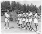 Andrew Jitkoff demonstrates proper tennis racket grip at Cimarroncita Ranch Camp